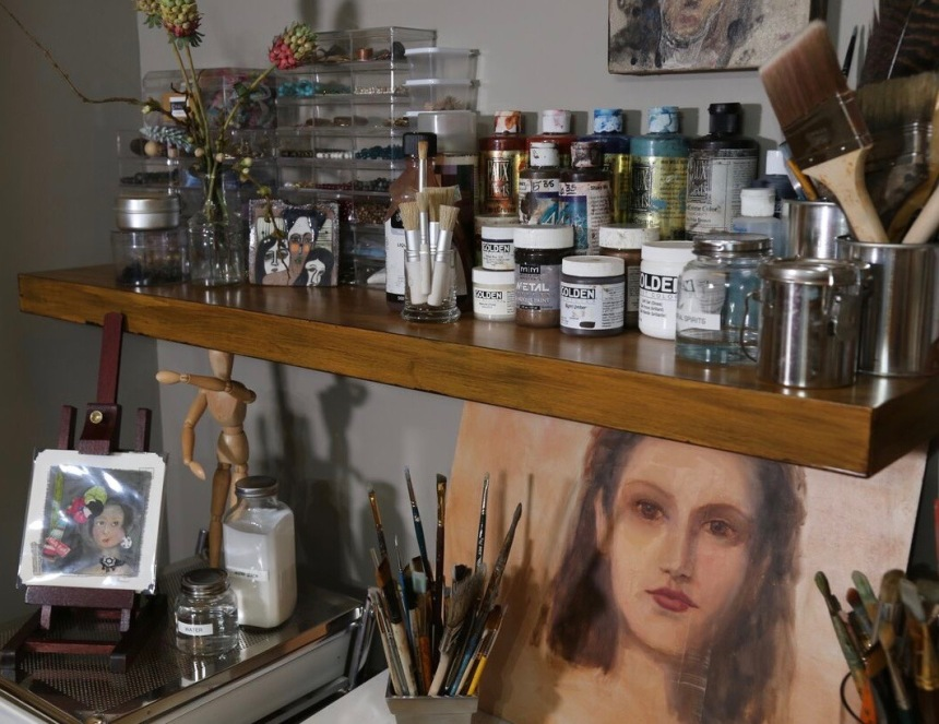 Converted closet - art studio. Floating shelves.